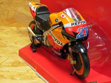 Picture of Casey Stoner Honda RC212V 2011 Repsol team 1:12 57403